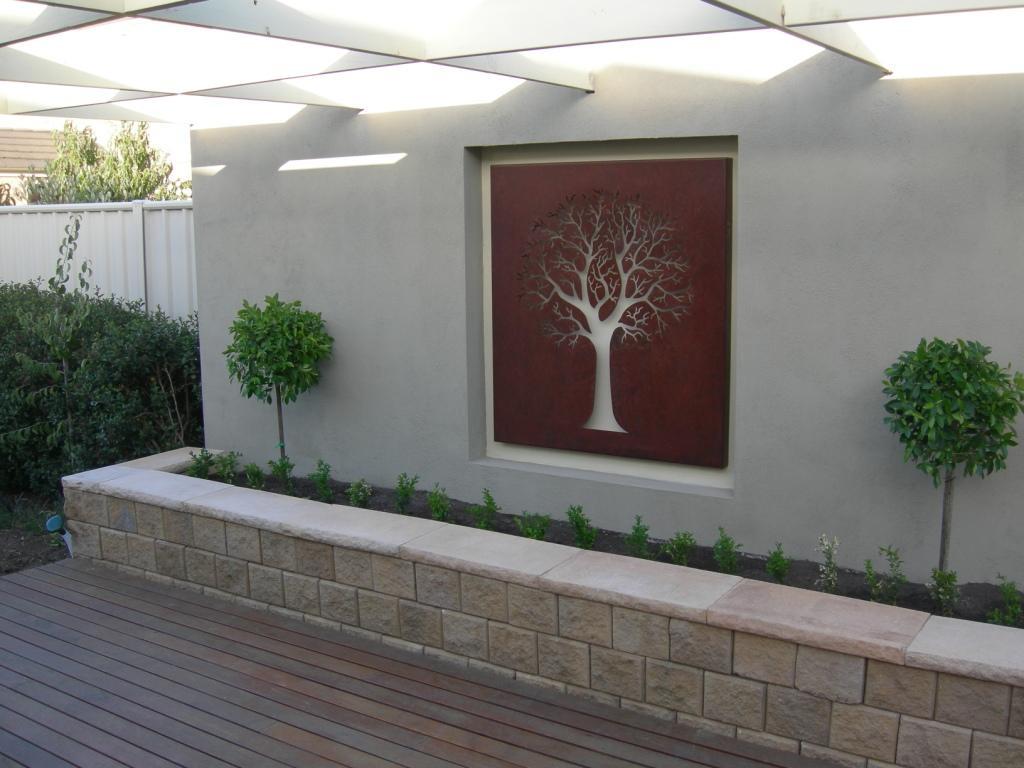 Qaq's corten 'maple' decorative screens decorate a boring backyard ...